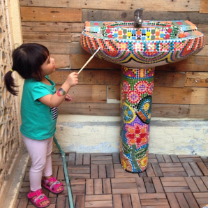 mosaic art on a scavenged sink